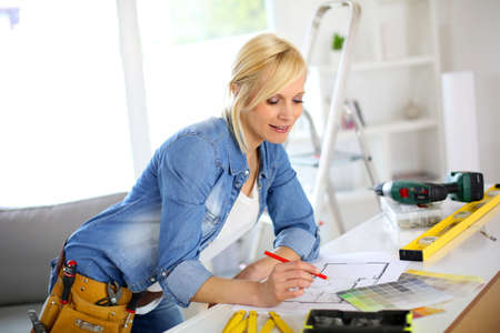Woman working on home improvement planning Stock Photo - 18918488