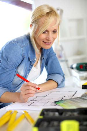 Woman working on home improvement planning photo