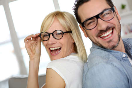 woman wearing glasses: Middle-aged couple wearing eyeglasses Stock Photo