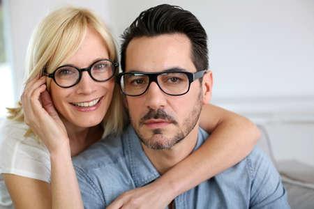 着て眼鏡の中年夫婦 写真素材
