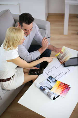 Couple looking at paint colors for new home Stock Photo - 18939673