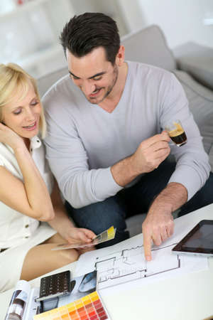 Couple looking at paint colors for new home Stock Photo - 18939653