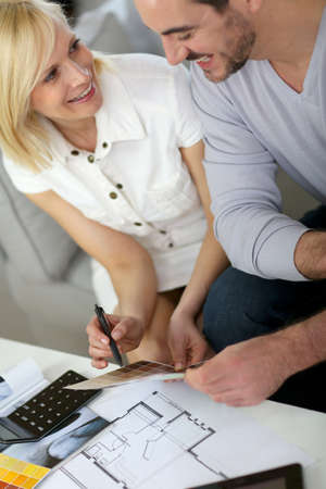 Couple looking at paint colors for new home photo