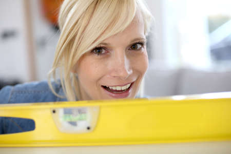 Closeup of blond woman looking through level Stock Photo - 18939722