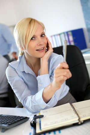 Portrait of businesswoman talking to client Stock Photo - 18939536