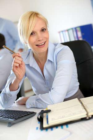 Portrait of businesswoman talking to client Stock Photo - 18939533
