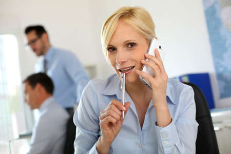 Businesswoman on the phone taking note on agenda Stock Photo - 18941743