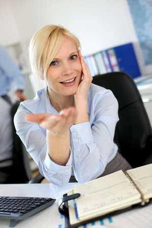 Portrait of businesswoman talking to client Stock Photo - 18941714