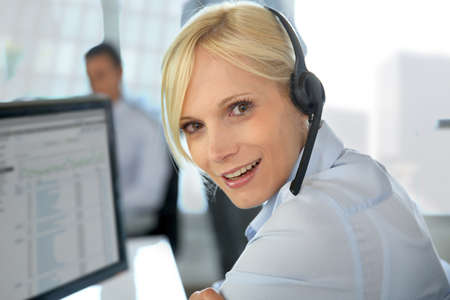customer assistant: Portrait of beautiful customer service operator Stock Photo