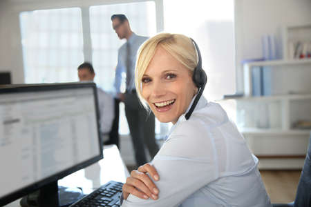telephone headsets: Portrait of beautiful customer service operator Stock Photo