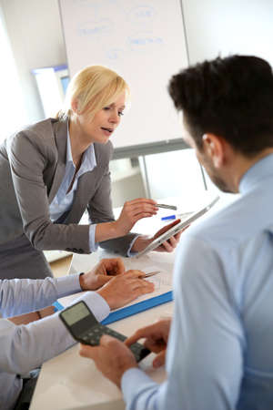 conference meeting: Executive woman making business presentation Stock Photo