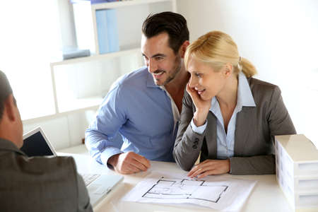 Couple meeting real-estate agent to buy property Stock Photo