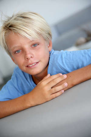 Portrait of young boy with blue eyes and shirt photo