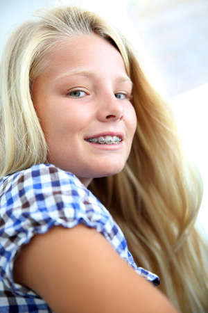 dentalcare: Portrait of teenager with braces