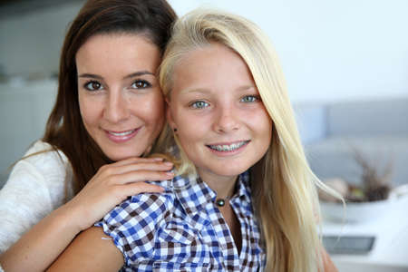 13: Portrait of young woman with teenager