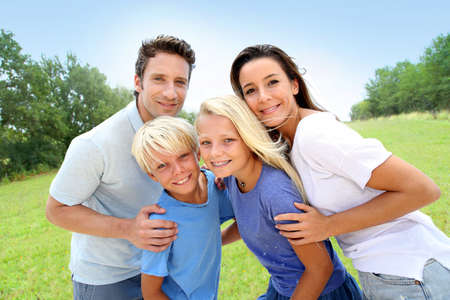 blonde boy: Portrait fo happy family standing in natural landscape