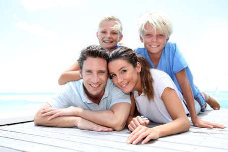 caribe: Portrait of cheerful family on vacation in Caribe Stock Photo
