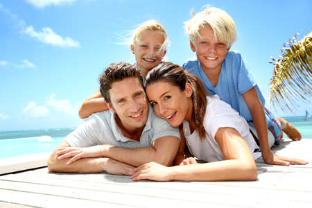 family vacation: Portrait of cheerful family on vacation in Caribe Stock Photo