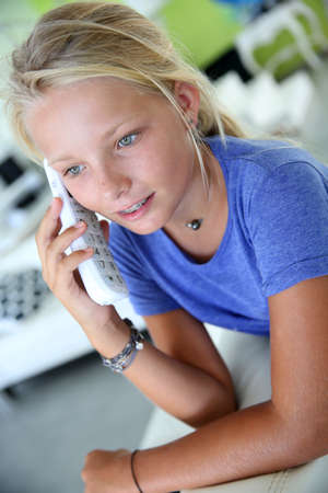teenaged girl: Teenaged girl talking on the phone