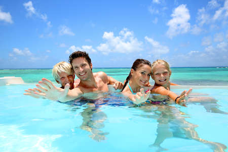 teen girl bikini: Family of four bathing in swimming pool