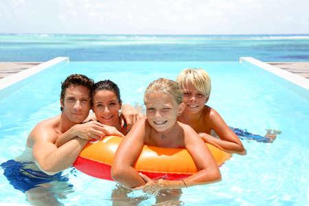 kids swimming pool: Couple with children enjoying bath time