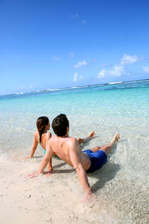 Couple relaxing in Carribean sea water photo