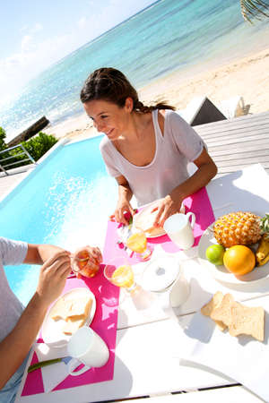 Couple enjoying breakfast in resort photo
