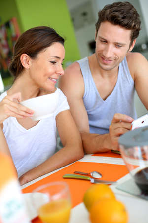 Couple having breakfast at home photo