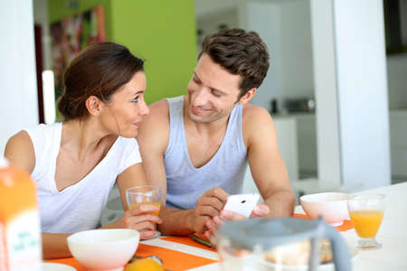 30 years old woman: Couple having breakfast at home