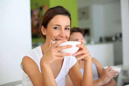 30 years old woman: Portrait of young woman having breakfast Stock Photo