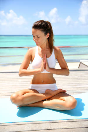 30 years old woman: Beautiful brunette girl in lotus position