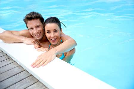 swimmingpool: Portrait of cheerful couple in swimming-pool