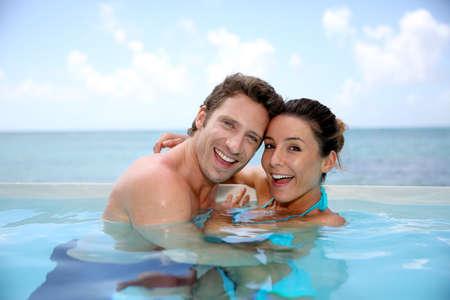 swimmingpool: Couple having fun in swimming-pool Stock Photo