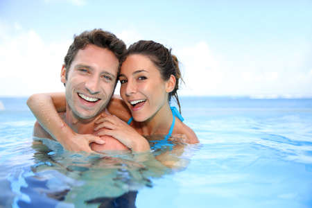 bathing man: Couple having fun in swimming-pool Stock Photo