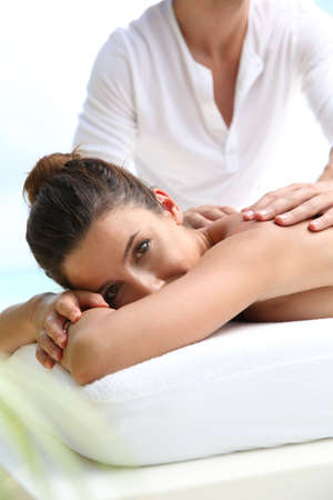 Brunette girl receiving a massage photo