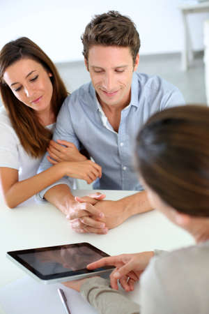 Young couple meeting financial adviser photo