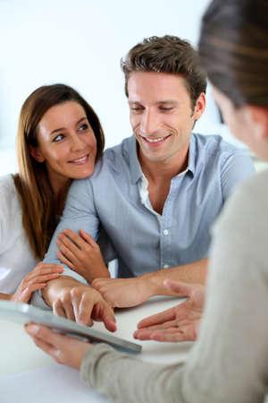 financial guidance: Young couple meeting financial adviser