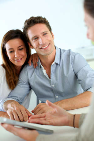 financial advisors: Young couple meeting financial adviser