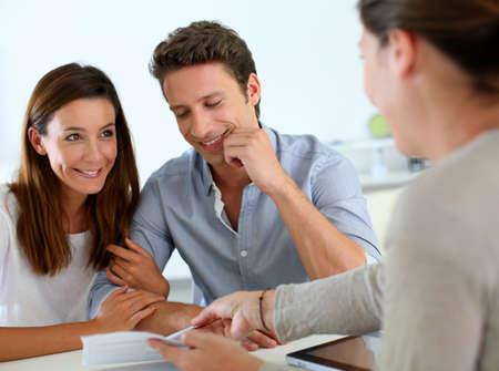 financial advice: Future property owners reading terms of contract