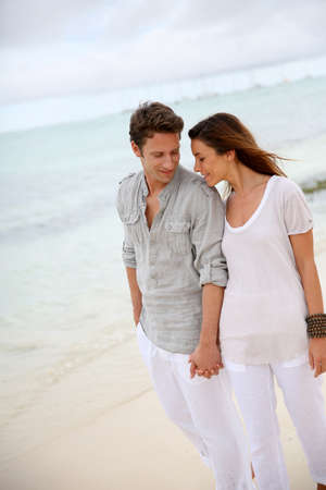lovers embracing: Romantic couple walking on the beach