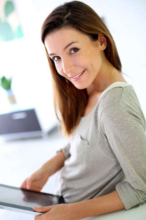 30 years old woman: Young woman using electronic tablet
