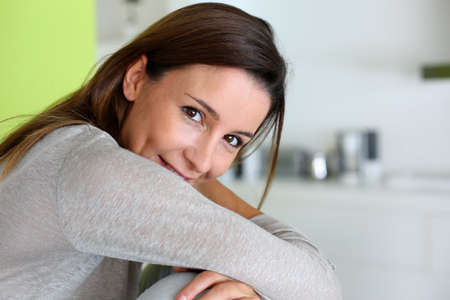 30 years old woman: Beautiful brunette girl relaxing at home Stock Photo
