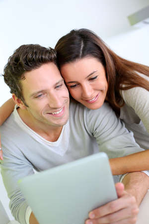 websurfing: Cheerful couple websurfing on internet with tablet