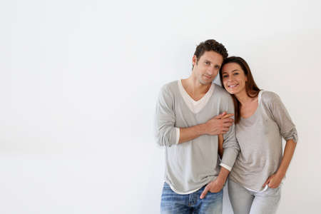 Couple standing on white background photo
