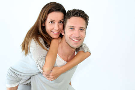 couple married: Handsome guy giving piggyback ride to girlfriend Stock Photo