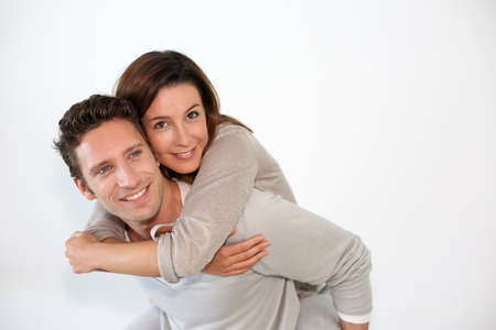 piggyback: Handsome guy giving piggyback ride to girlfriend Stock Photo