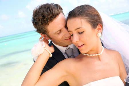 Couple celebrating wedding on the beach photo