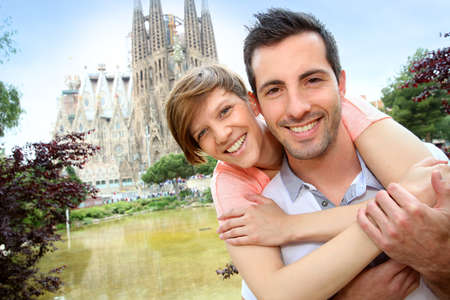 Couple standing by the Sagrada familia church, Spain photo