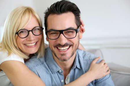 funny glasses: Middle-aged couple wearing eyeglasses Stock Photo
