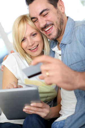 Couple shopping on internet with credit card photo